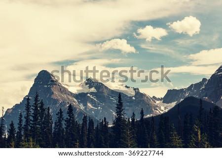 View over a river through the Rocky Mountains, Banff, Canada - stock photo