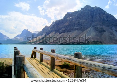 View over a wooden bridge at Bow Lake, Banff National Park, Canada - stock photo