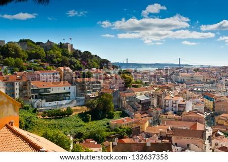 View over Baixa and Castelo de Sao Jorge from Alfama, Lisbon, Portugal - stock photo