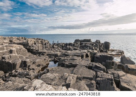 View over basalt tock formations at the rough coastline of Neist Point, Isle of Skye, Scotland, UK - stock photo
