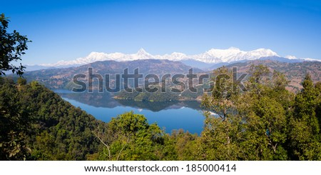 View over Begnas Tal to the Annapurna Range, Nepal - stock photo