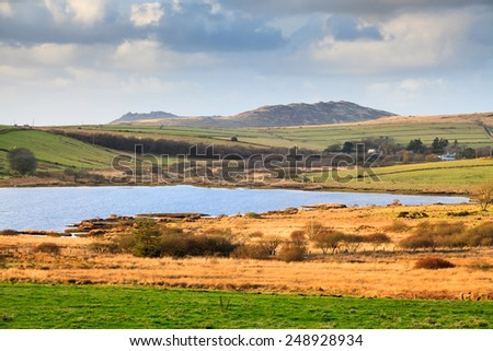 View over Colliford Lake with Brown Willy and Rough Tor hills in the distance, the highest and second highest points in Cornwall England UK - stock photo