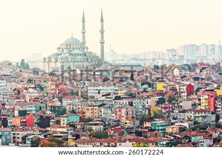 View over Istanbuls dense residential area with the Fatih Mosque in sunlight - stock photo