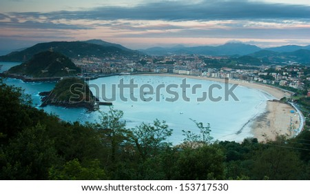 View over La Concha Beach from Monte Igeldo, San Sebastian, Spain at Sunset - stock photo