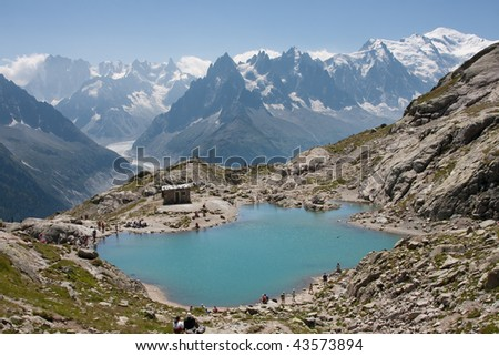 View over Lac Blanc to the Mont Blanc mountain range. Lac Blanc is situated in the Aiguille Rouge near Chamonix, France. - stock photo
