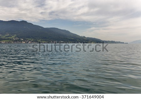 View over lake and village Attersee in Austrian Alps - stock photo