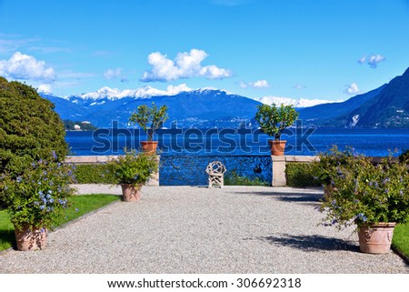 View over Lake Maggiore and Alps mountains from the Isola Bella Island  in Northern Italy. - stock photo