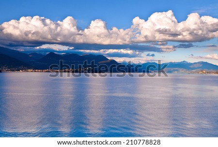 View over Lake Maggiore and Swiss Alps mountains from Italian side in Northern Italy.