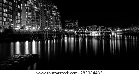 View over river to Salford Quays England. Long exposure monochrome.