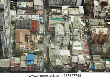 View over rooftops  of simple quarters in Bangkok