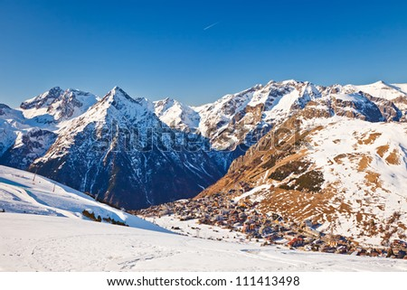 View over ski resort in French Alps - stock photo