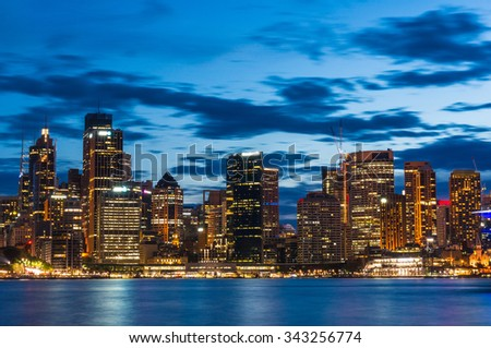View over Sydney Business District and King Street wharf at night - stock photo