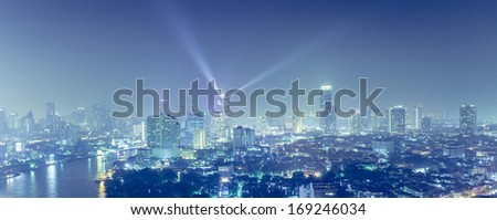 View over the big asian city of Bangkok , Thailand at nighttime when the tall skyscrapers are illuminated  - stock photo