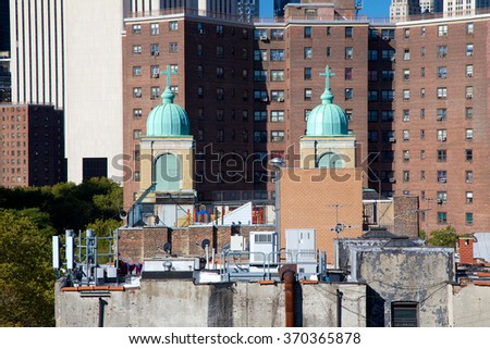 View over the chaotic mixture of architectural style and purpose that is the historic Lower East Side, NY, USA. - stock photo
