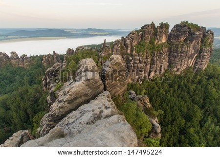 View over the famous Schrammsteine during sunrise - stock photo