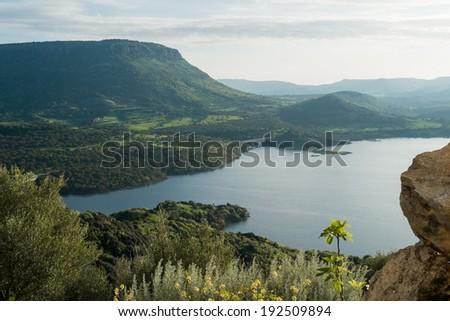 View over the lake from Rocca Doria, a rock in Monteleone Rocca Doria, Sardinia, Italy - stock photo