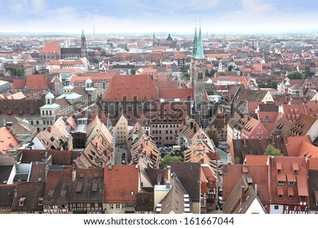 View over the old town of Nuremberg with the spires of St Sebald church and St Lorenz church, the town hall and the opera house, in Franconia, Bavaria, Germany.