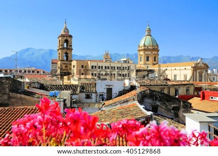 View over the rooftops and churches of Palermo, Sicily with vibrant flowers - stock photo