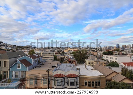 View over the rooftops of San Francisco from the Castro/Mission-Dolores area in San Francisco, CA in October 2014. - stock photo