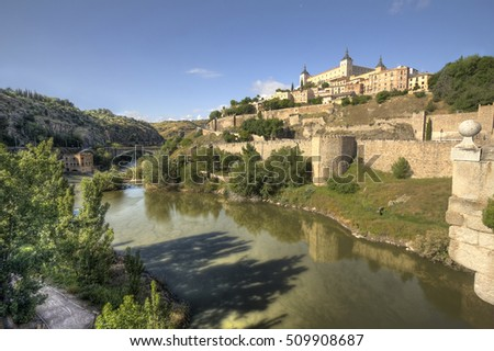 View over the Tagus river and the city walls of Toledo in Spain from the Alcantara bridge