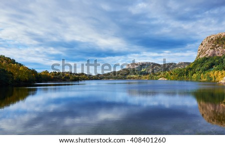 View over the very calm lake Eikelivatnet in the Stavanger area of southern Norway - stock photo