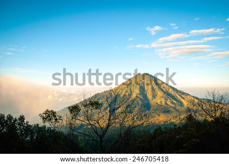 View over volcanic landscape of mountains at Kawah Ijen in morning dawn, Java, Indonesia - stock photo