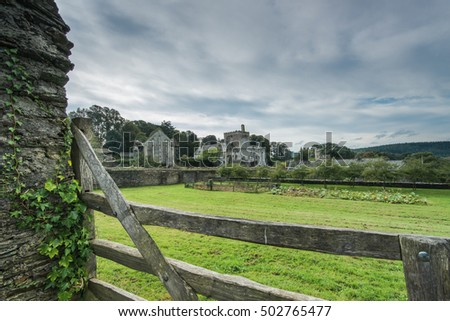View over wooden fence over english countryside heritage and garden