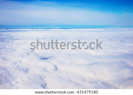 view panorama cloudscape from airplane window - stock photo