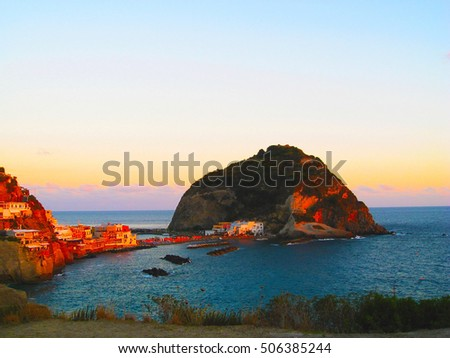 View panorama of Sant'Angelo on island of Ischia in Italy: Tyrrhenian Sea, rocks, water, sand on island in front of Naples, in Campania region in sunset