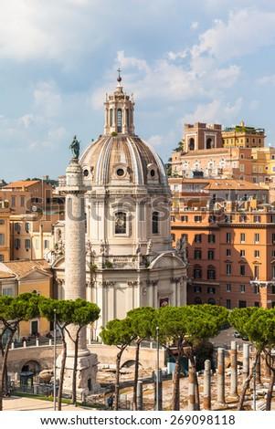 View Santa Maria di Loreto church and Trajan's Column in Rome, Italy, near the giant Monument of Vittorio Emanuele II. - stock photo