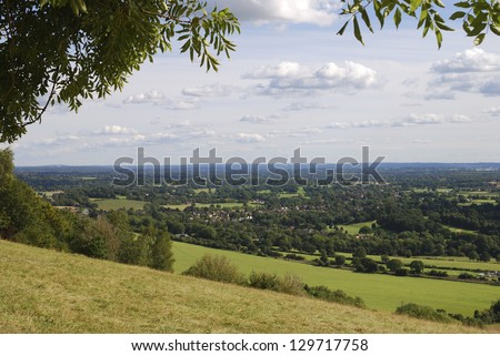 View South over countryside from Box Hill on the North Downs at Dorking. Surrey. England - stock photo
