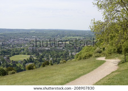 View south over Dorking and the countryside from Box Hill. Surrey. England. With heat haze. - stock photo