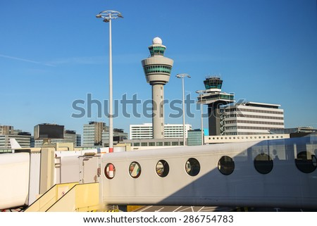 View the control tower and other buildings from the window of the airport