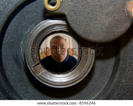 View through a door peephole. Criminal behind residential doors. Security peephole in the door & View Through Door Peephole Criminal Behind Stock Photo (100% Legal ...