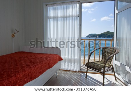 View through an open door of the sea sunny summer day. - stock photo