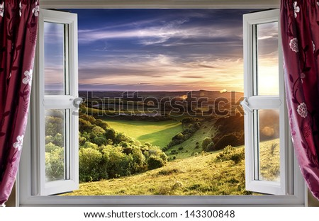 View through an open window onto beautiful landscape