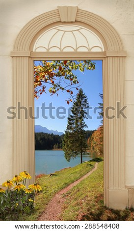 view through arched door, autumnal hiking trail at alpine lakeside - stock photo