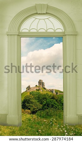 view through arched door, landscape with old castle - stock photo