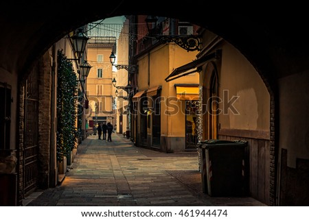 View through archway on the street, Parma, Emilia-Romagna, Italy.