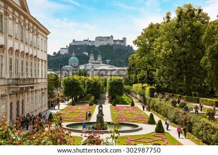 View through beautiful gardens to historic castle, Salzburg Austria - stock photo
