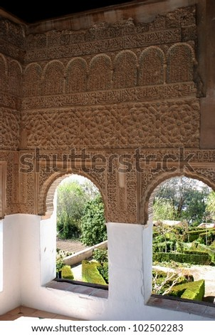 View through Moorish windows of the Generalife, Place of Alhambra, Granada, Granada Province, Andalusia, Spain, Western Europe.