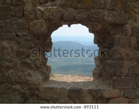 View through on a window of Chateau de Queribus, Languedoc, France. An area rich in history and vineyards