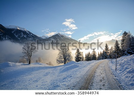 View to a winter landscape with trees and mountain range of Gasteinertal valley near Bad Gastein, Pongau Alps - Salzburg Austria Europe - stock photo