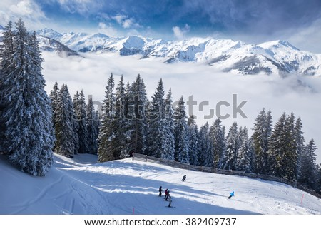 View to Alpine mountains in Austria from Kitzbuehel ski resort - one of the best ski resort in the workd with 54 cable cars, 170 km prepared skiing slopes and place of famous hahnenkamm races.