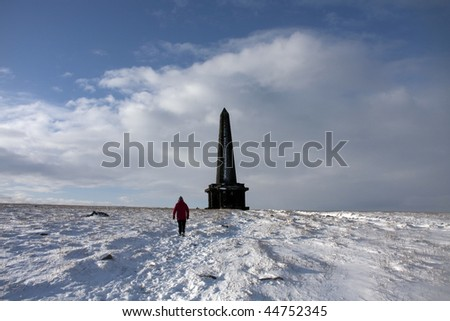 View to and from Stoodley Pike Monument in the snow West yorkshire