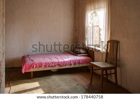 View to bedroom in abandoned house - stock photo