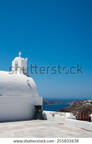 View to caldera from the street in Oia, Santorini island, Greece - stock photo