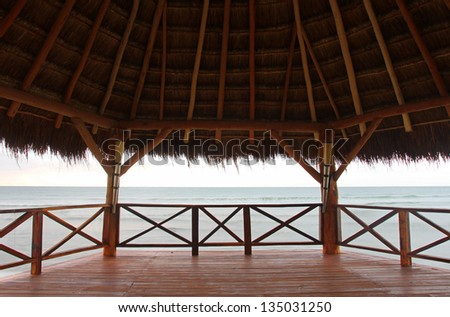 View to Caribbean sea from straw roof gazebo. - stock photo