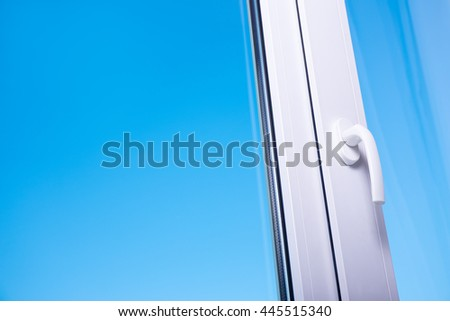 view to clear blue sky from modern plastic window