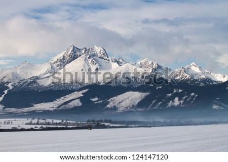 View to High Tatras mountain range covered by snow in winter time,  Slovakia - stock photo
